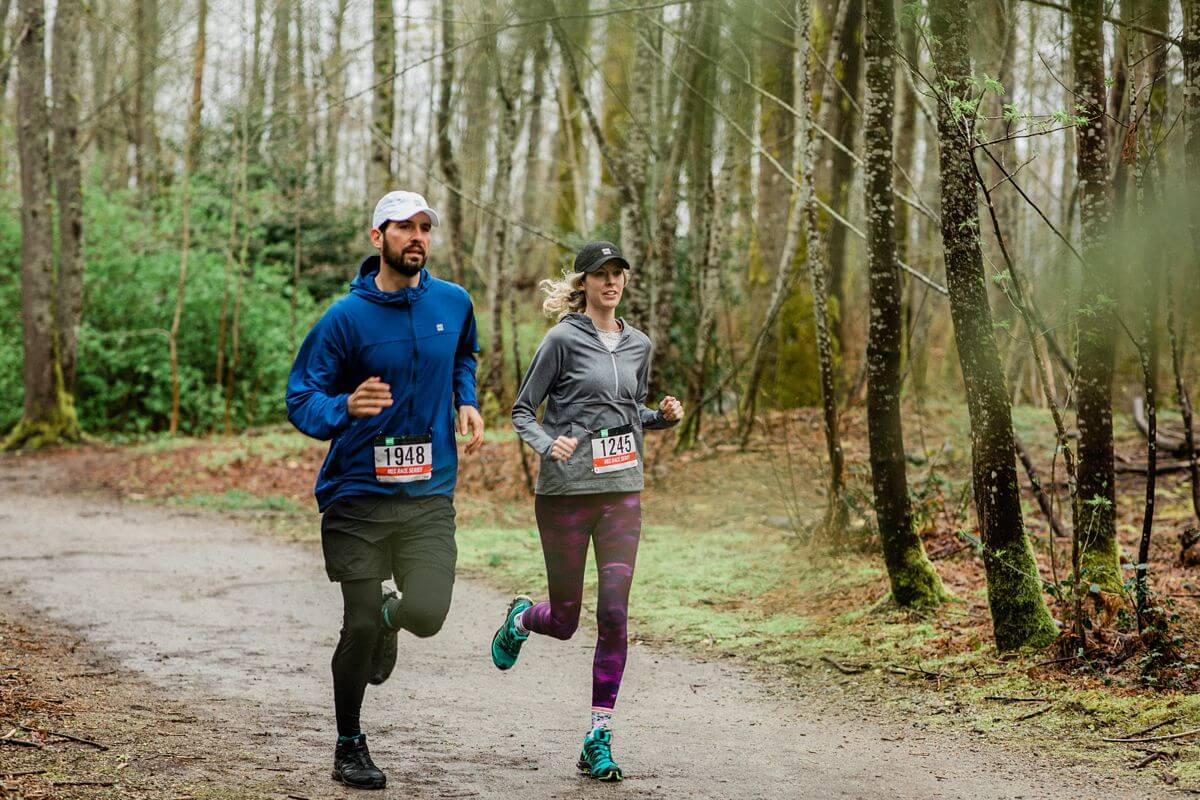 pair of runners in the forest