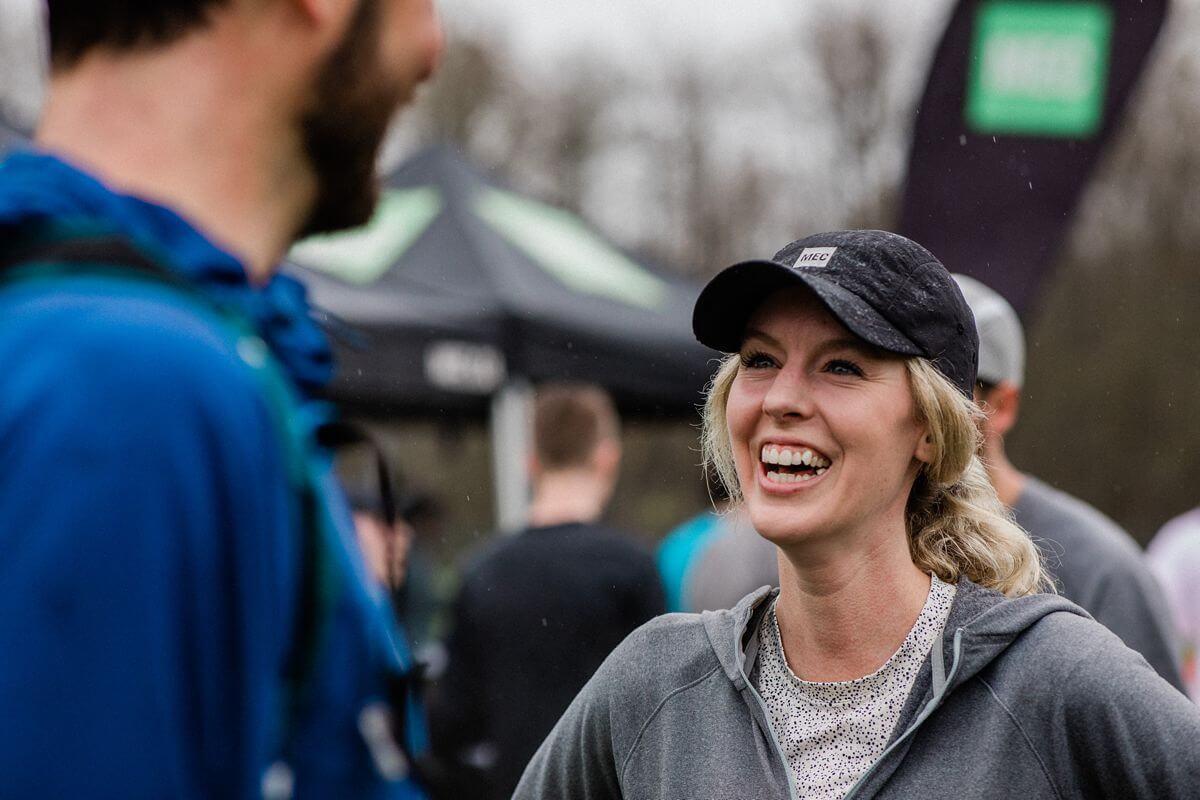 Female runner laughing at MEC race