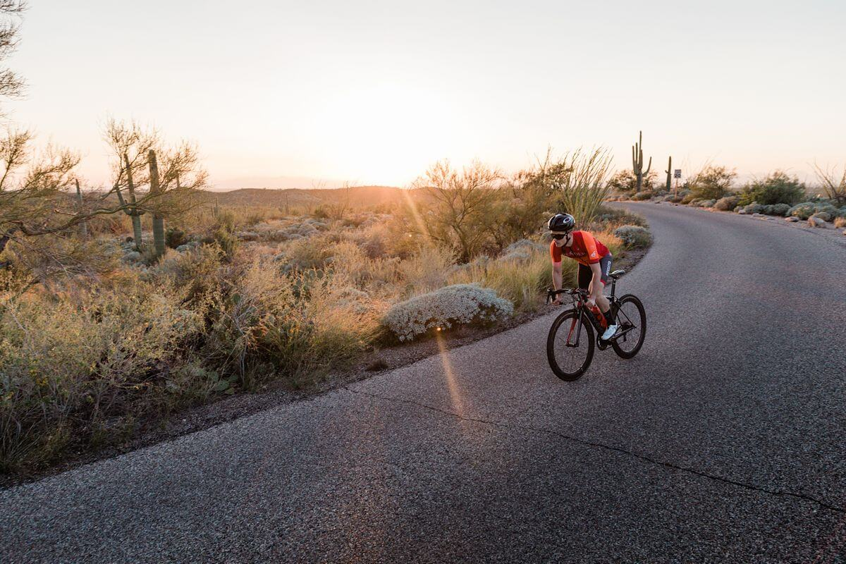 Cyclist riding in Arizona at sunset