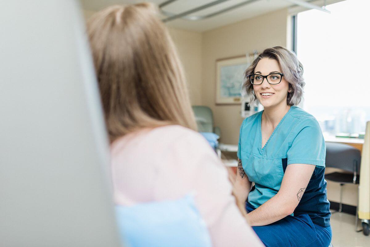 female nurse sitting with patient