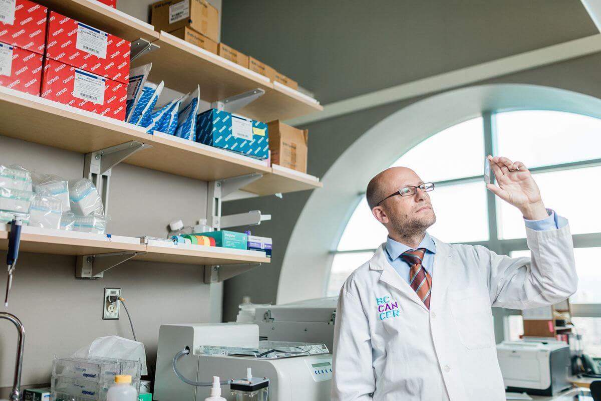 Scientist holding microscope slide